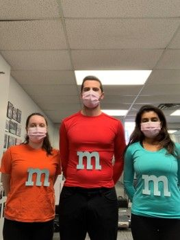 3 people with M pasted on their t-shirts
