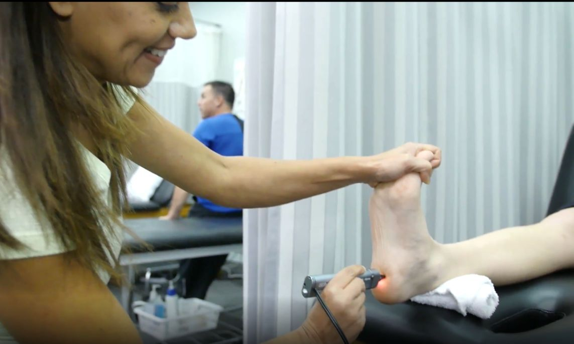 doctor stretching patient foot