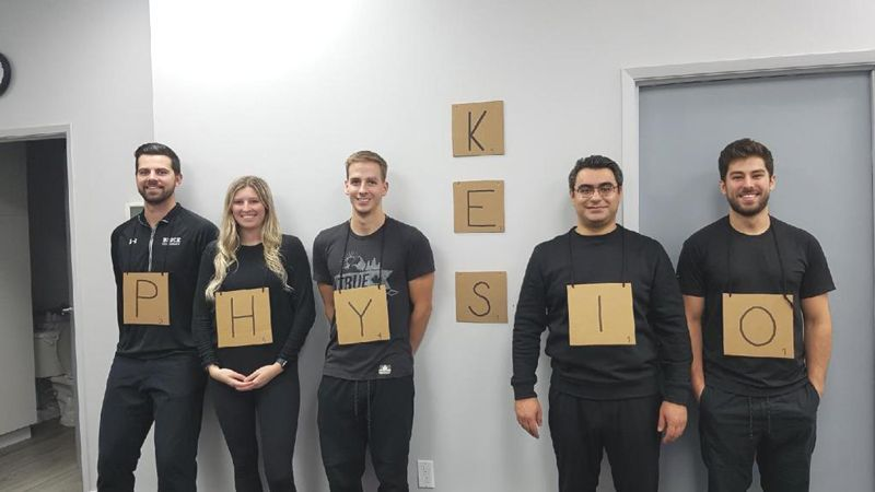 people displaying Kes physio by wearing letters