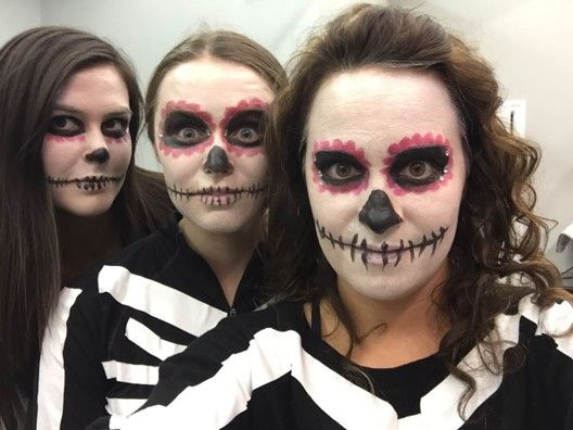 3 people in skeletal makeup