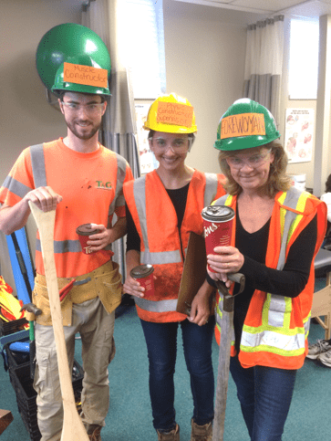 3 people wearing construction uniforms