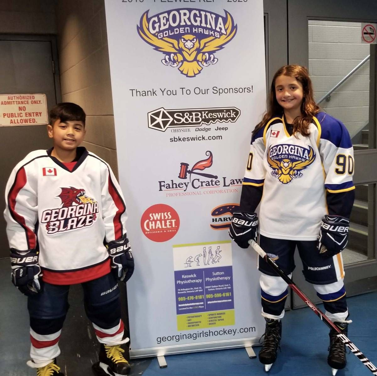 2 kids wearing ice hockey dress
